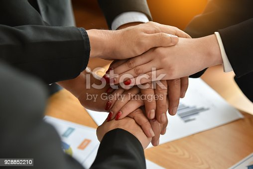 istock Business people Stacking Hands. 928852210