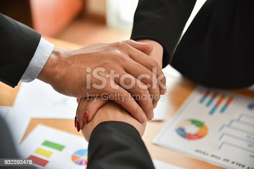 istock Business people Stacking Hands. 932393478