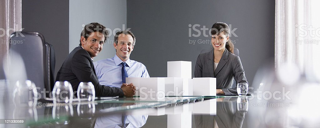 Business people stacking white cubes in conference room stock photo