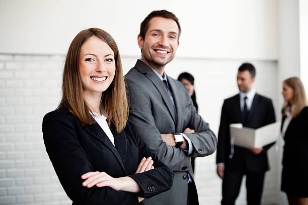 business people stainding - woman suit stock photos and pictures