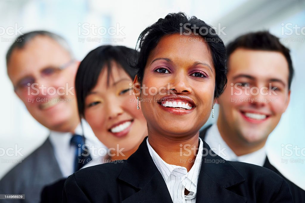 Business people standing in a line and smiling royalty-free stock photo