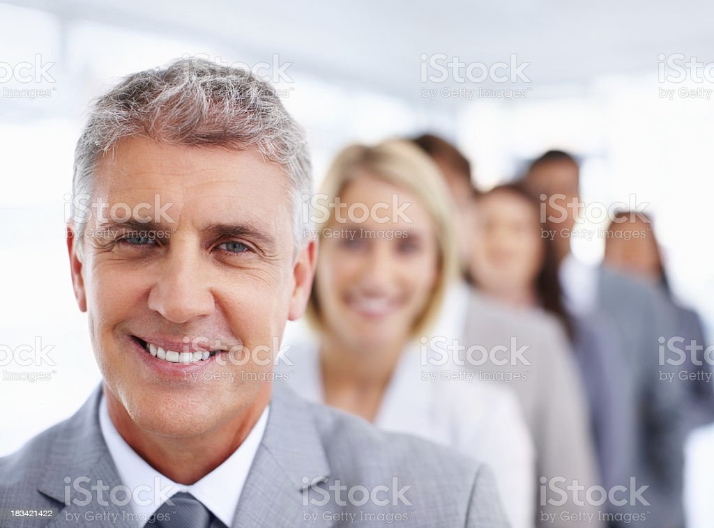 Business people standing in a row royalty-free stock photo