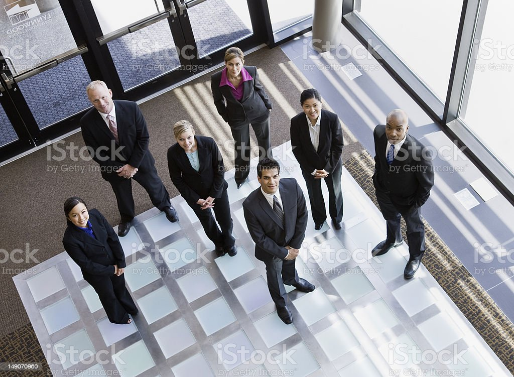 Business People Standing in Office Lobby royalty-free stock photo