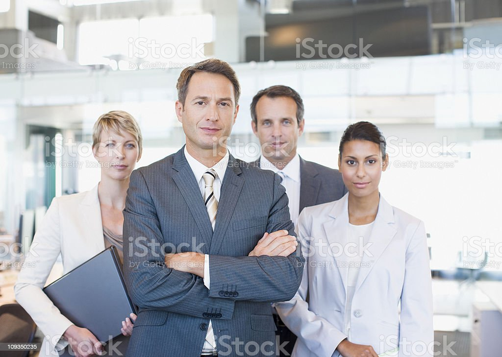 Business people standing in office together stock photo
