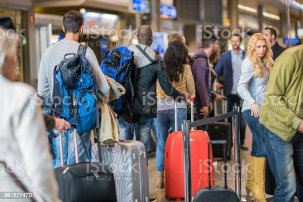 Business people standing in queue at airport picture id991877470?b=1&k=6&m=991877470&s=612x612&h=7paj76b9imrpje8qwkvcjqp0lg7s2n8mds s436jndm=