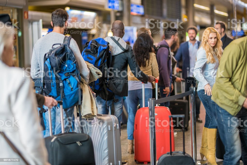 Business people standing in queue at airport stock photo