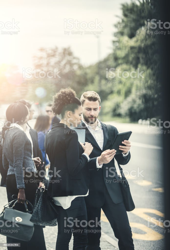 Business People Standing in Street and Discussing stock photo