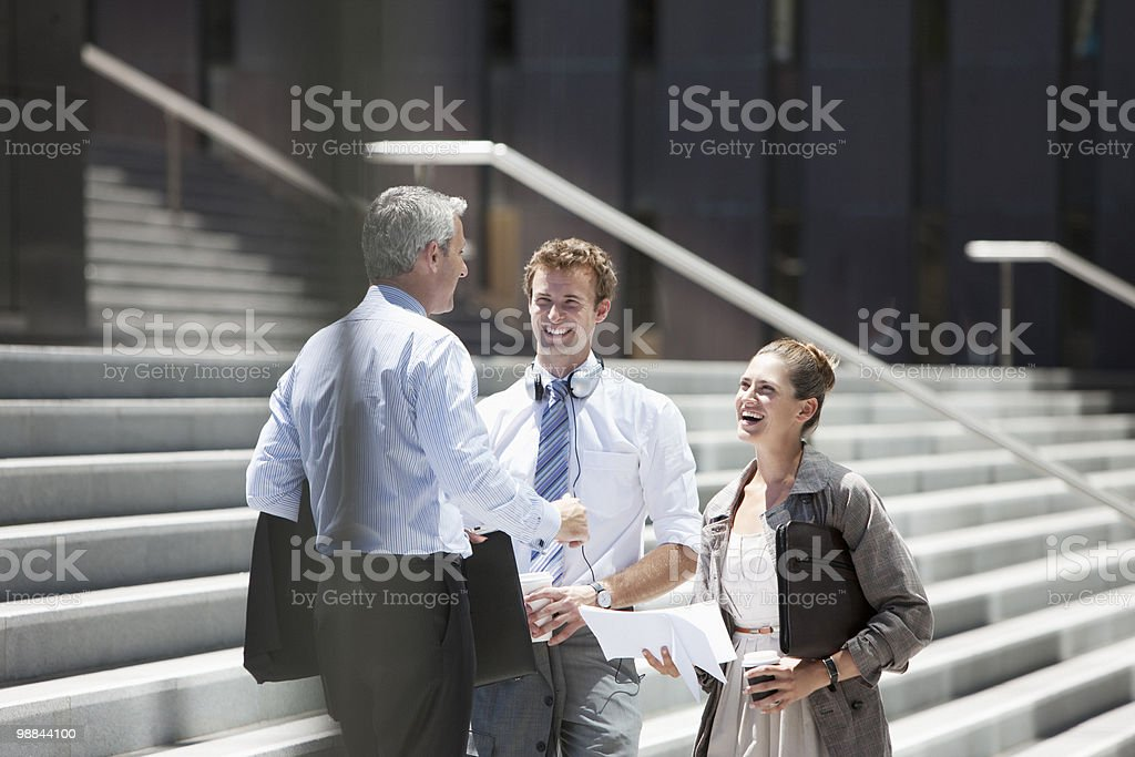 Business people standing on steps outdoors stock photo
