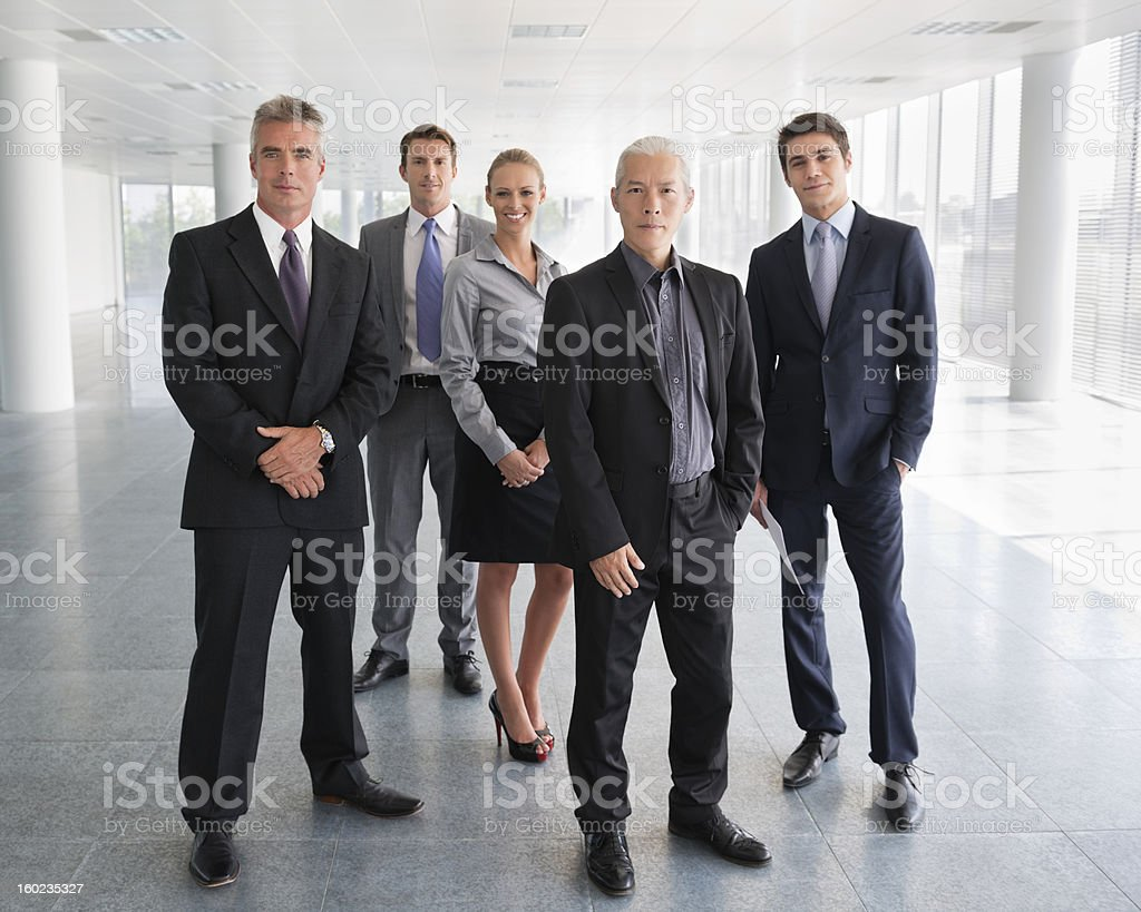 Business People Standing Together In Office Lobby stock photo