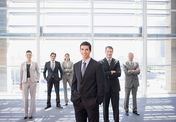 Business people standing together in office stock photo