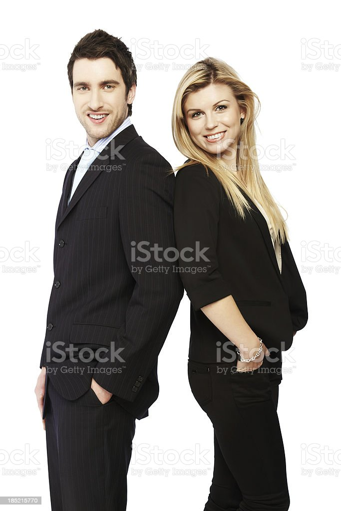 Business people standing with hands in pocket royalty-free stock photo