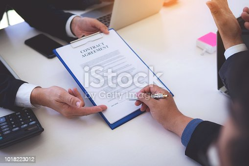 1008974324 istock photo Business people successful signing construction contract at office. 1018223012