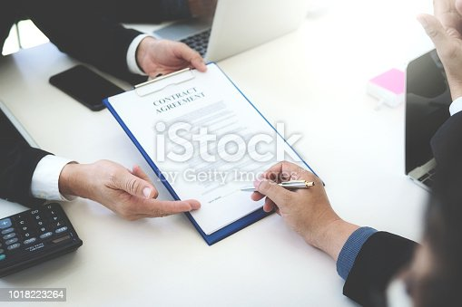 1008974324 istock photo Business people successful signing construction contract at office. 1018223264