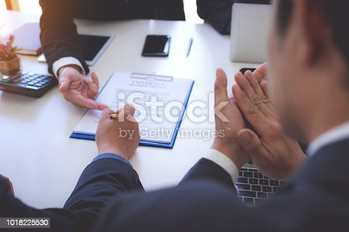 1008974324 istock photo Business people successful signing construction contract at office. 1018225530