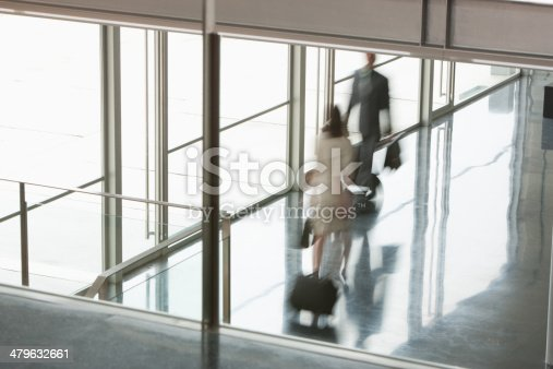 istock Business people suitcases in building lobby 479632661