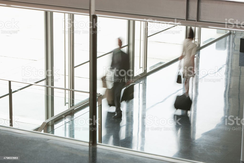 Business people suitcases in building lobby stock photo