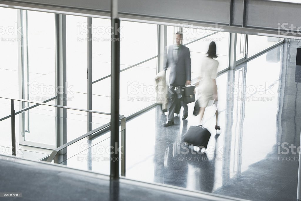 Business people suitcases in building lobby royalty-free stock photo