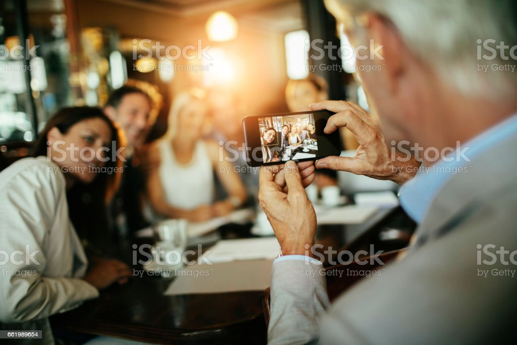 Business people taking a picture royalty-free stock photo