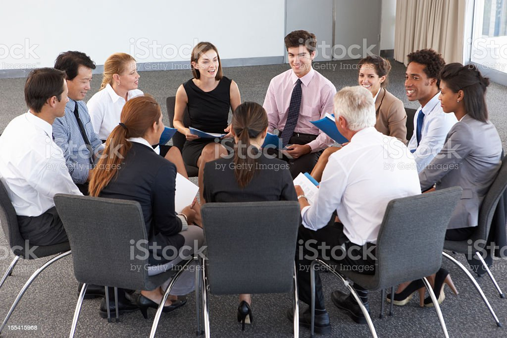 Business people taking part in company seminar stock photo