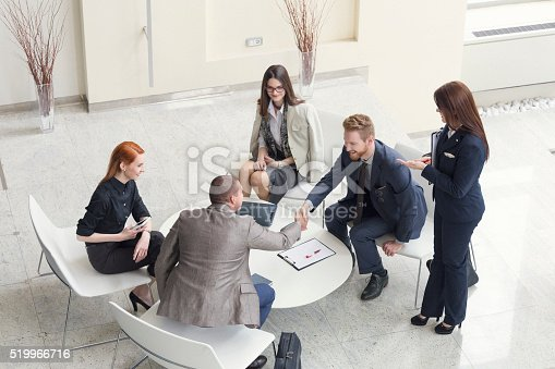 istock Business people talking and shaking hands shot from above 519966716
