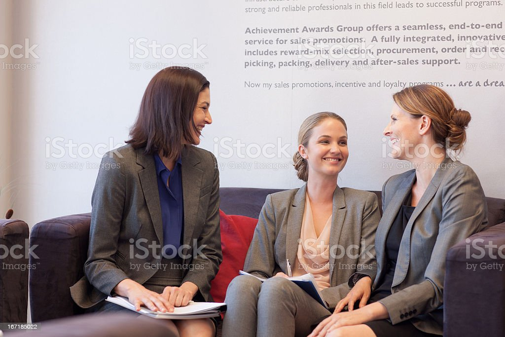 Business people talking face to face in lobby royalty-free stock photo