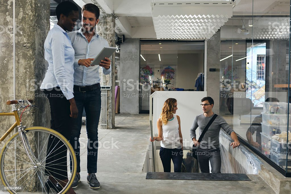 Business People Talking In A Office Corridor. stock photo