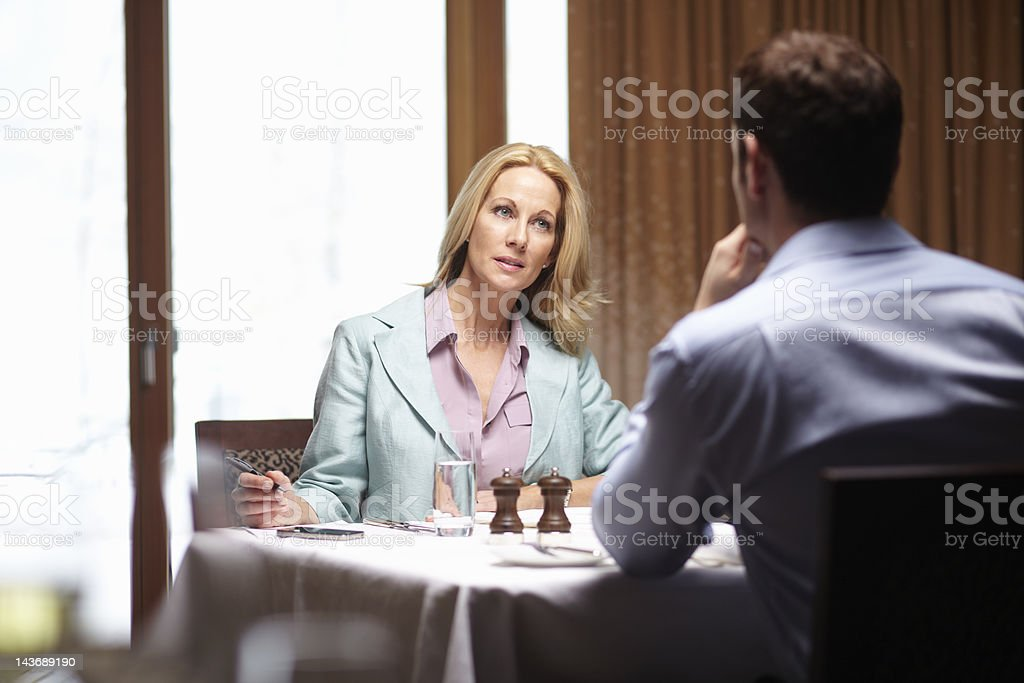 Business people talking in cafe stock photo