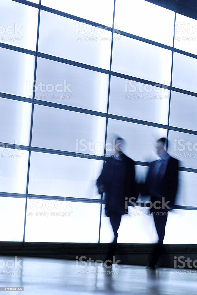 Business people talking in front of windows royalty-free stock photo