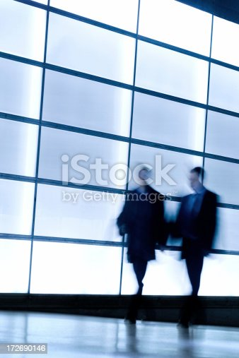 istock Business people talking in front of windows 172690146