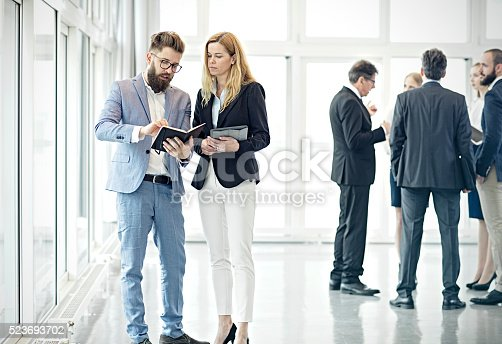 istock Business people talking in lobby 523693702