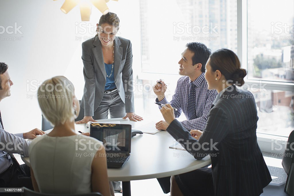 Business people talking in meeting stock photo