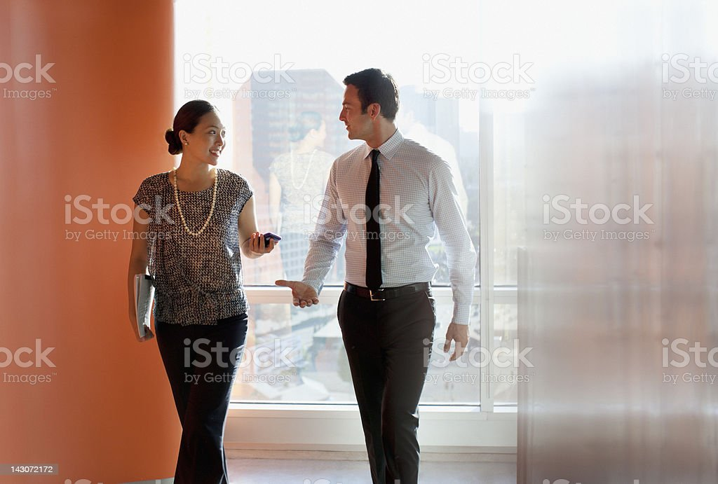 Business people talking in office stock photo