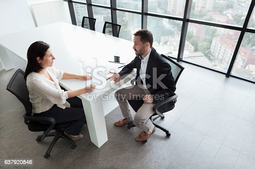 istock Business people talking in office 637920846