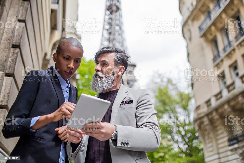Business people talking in the streets of Paris.