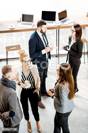 istock Business people talking indoors 926547136