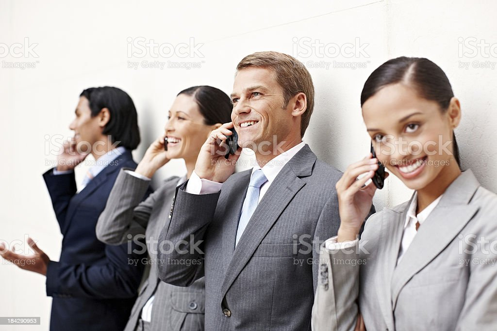 Business People Talking on Cellphones royalty-free stock photo