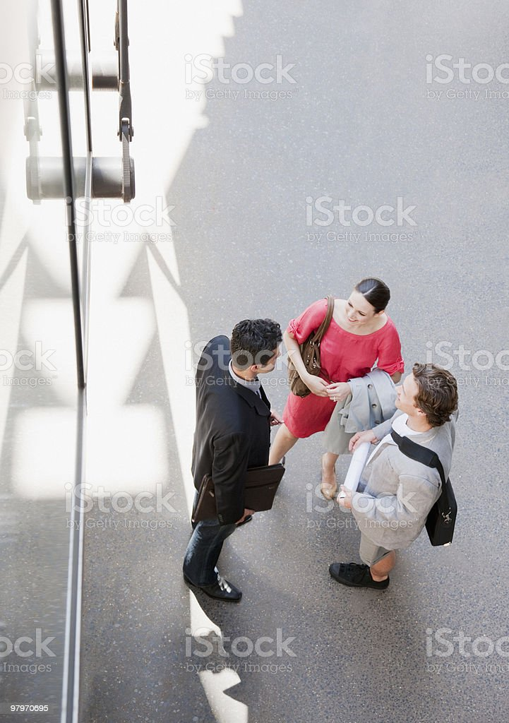 Business people talking on sidewalk royalty-free stock photo