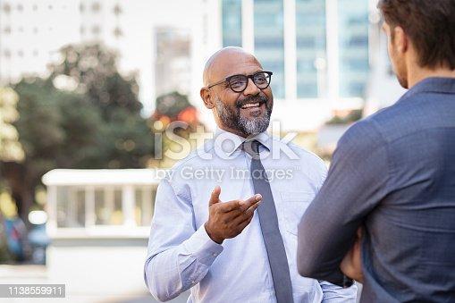 istock Business people talking outdoor 1138559911