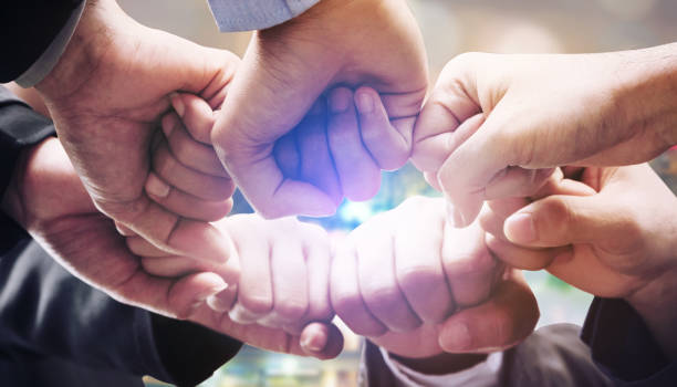 Business people team joining hands. stock photo