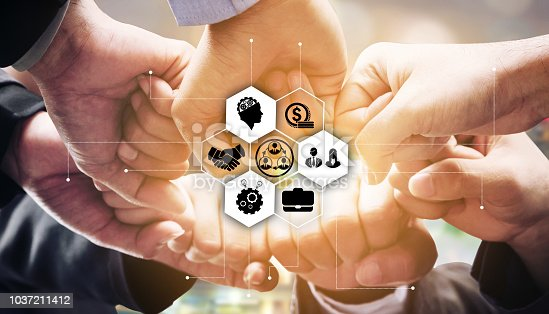 istock Business people team joining hands. 1037211412