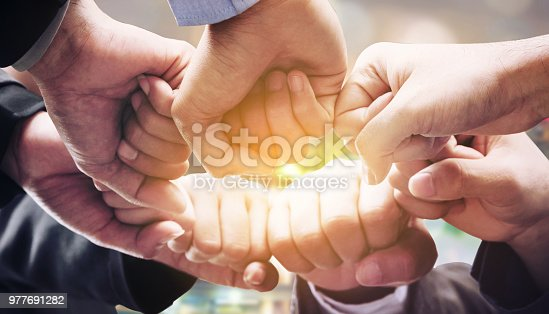istock Business people team joining hands. 977691282