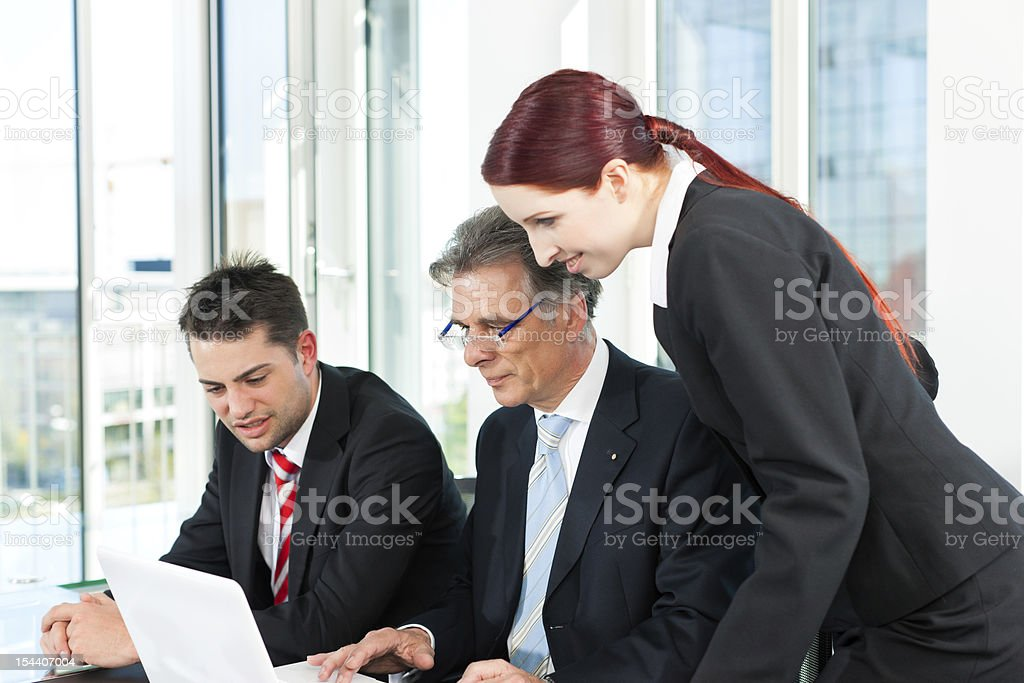 Business people - team meeting in an office royalty-free stock photo
