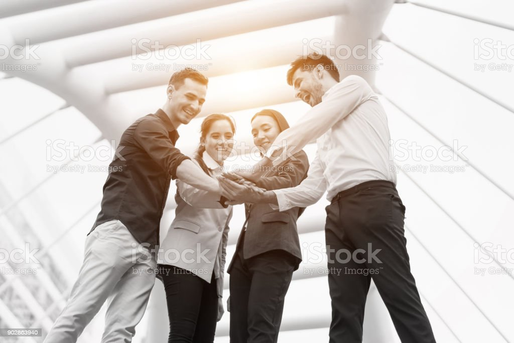 Business people team meeting put their hands together at outdoors. Concept of teamwork, team success, people creative, business people and power of group. stock photo