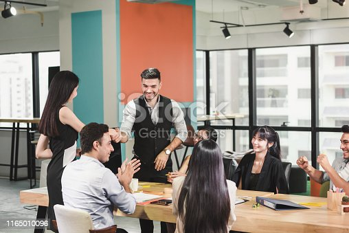924519152 istock photo Business People Teamwork are Meeting Conference and Congratulations to Successful of Their Project. Group of Employees Colleagues Congrated to Partnership After Dealing Complete, Business and Creative 1165010096