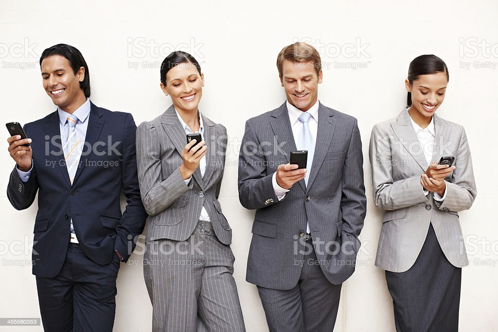 Business People Texting on Cellphones royalty-free stock photo