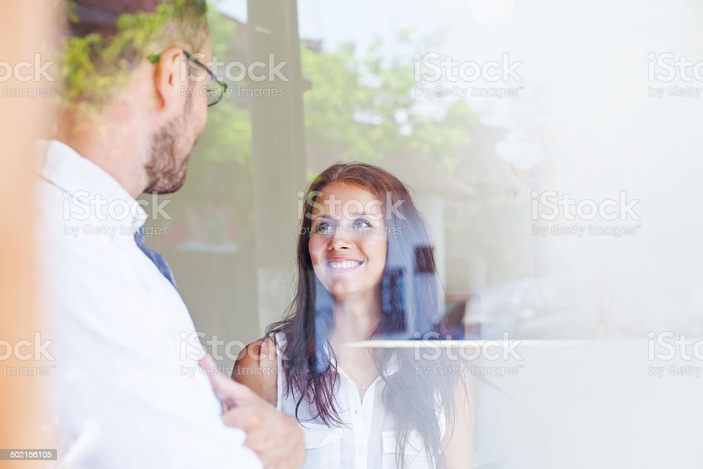 business people through the glass stock photo