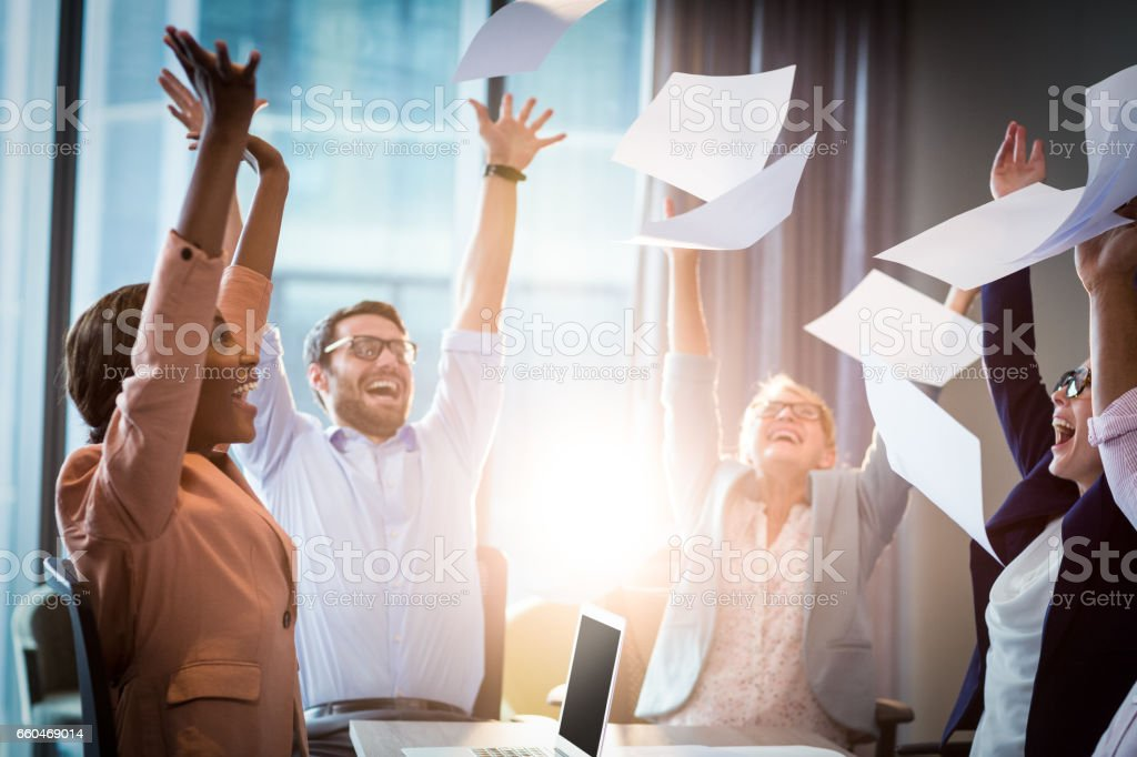 Business people throwing papers in the air stock photo