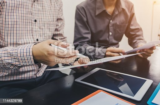 istock Business people to comment on investment and marketing plan in the meeting. 1144329789