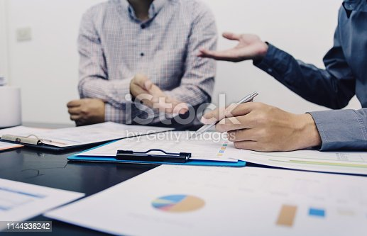 istock Business people to comment on investment and marketing plan in the meeting. 1144336242