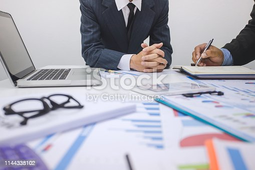 istock Business people to comment on investment and marketing plan in the meeting. 1144338102
